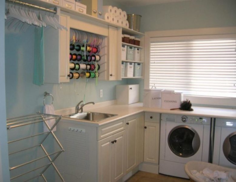 basement laundry room with sink